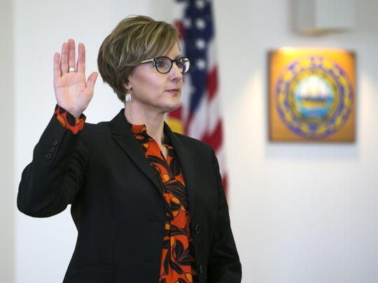 Attorney Jaye Rancourt is sworn in during the first day of a hearing for Owen Labrie on whether he deserves a new trial, on Tuesday, Feb. 21, 2017 in Concord, N.H. Labrie claims his trial lawyers failed to challenge the felony charge. He was acquitted in 2015 of raping a 15-year-old classmate as part of a game of sexual conquest at St. Paul's School but was convicted of a felony computer charge requiring him to register as a sex offender.
