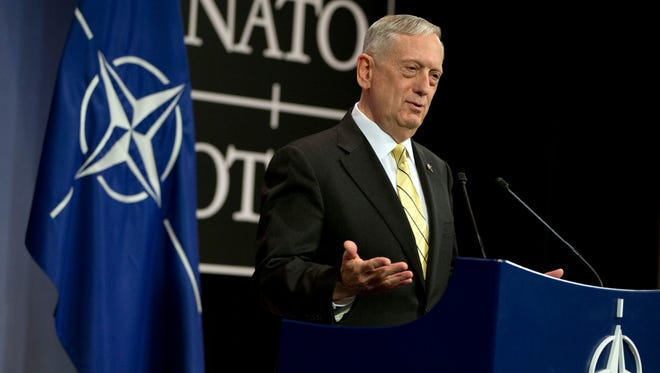 "U.S. Secretary of Defense Jim Mattis speaks during a media conference at NATO headquarters in Brussels on Thursday, Feb. 16, 2017. Mattis has told NATO ministers that the alliance is ""a fundamental bedrock for the United States"" while at the same time demanding an increased financial commitment from the 27 other alliance members."