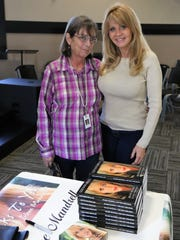 Pat Johnson poses with Irlene Mandrell Friday at Mandrell's book signing at TCA in Jackson.