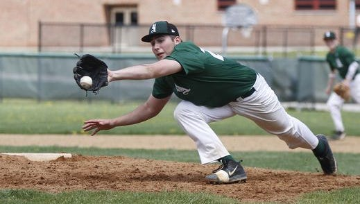 Yorktown starting pitcher James Starley (28) reaches for a hit back to the mound during a varsity baseball game against Lakeland at Yorktown High School on Saturday, April 23, 2016.