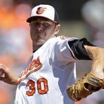 Baltimore Orioles starting pitcher Chris Tillman throws to the Houston Astros in the first inning of a baseball game on Sunday.