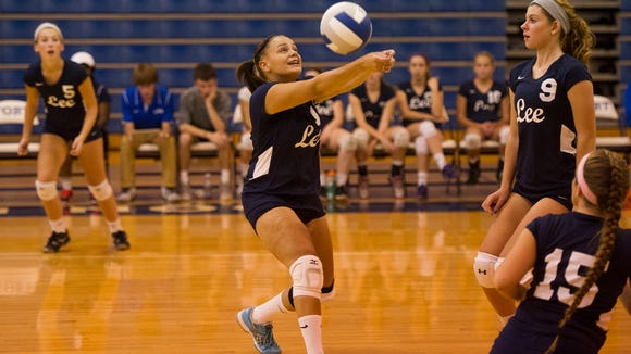 Robert E. Lee's Amber Johnson hits a ball from Fort Defiance during their game on Tuesday, Sept. 30, 2014.