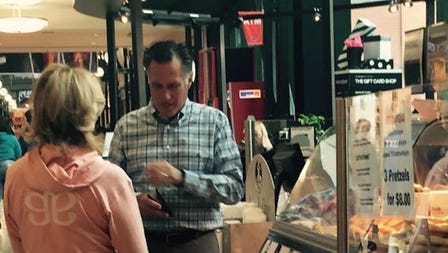 Mitt Romney enjoys a pretzel at Circle Centre mall on April 6, 2015.