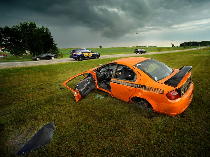 An orange Dodge SRT-4 was involved in a single-vehicle, multiple rollover accident near the intersection of Hwy 151 and Hwy W on Tuesday, July 29, 2014 in Eaton. The male driver of the vehicle was transported with multiple unreleased injuries. Matthew Apgar/HTR Media