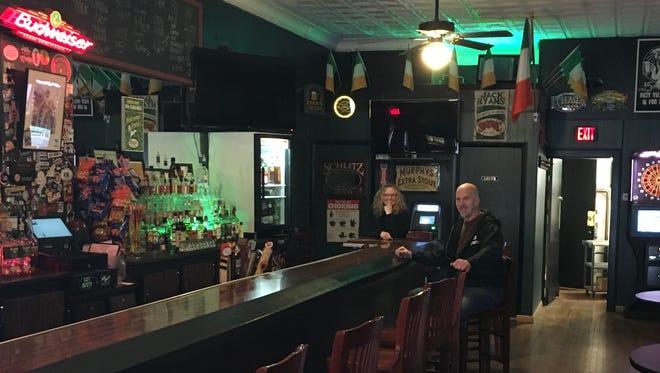 "Karen and Joe Ryan sharing a quiet moment at their 'neighborhood bar of Irish descent'."""