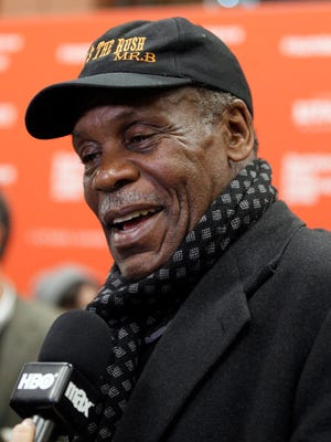 """Danny Glover takes interviews at the premiere of """"Complete Unknown."""""""