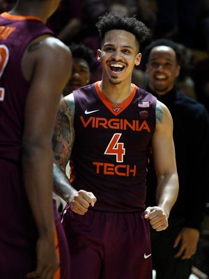 Virginia Tech Hokies guard Seth Allen (4) reacts following a made basket against the Virginia Cavaliers at Cassell Coliseum.