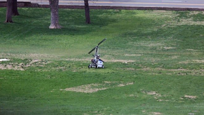 A small device resembling a helicopter is seen on the West Front of the Capitol in Washington, Wednesday, April 15, 2015, after landing.