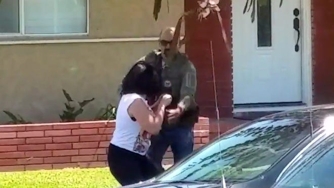 Officer snatches a woman's mobile phone
