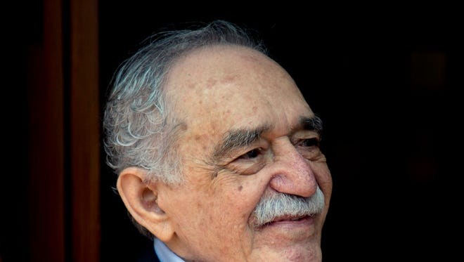 FILE - In this March 6, 2014 file photo, Colombian Nobel Literature laureate Gabriel Garcia Marquez greets fans and reporters outside his home on his 87th birthday in Mexico City.