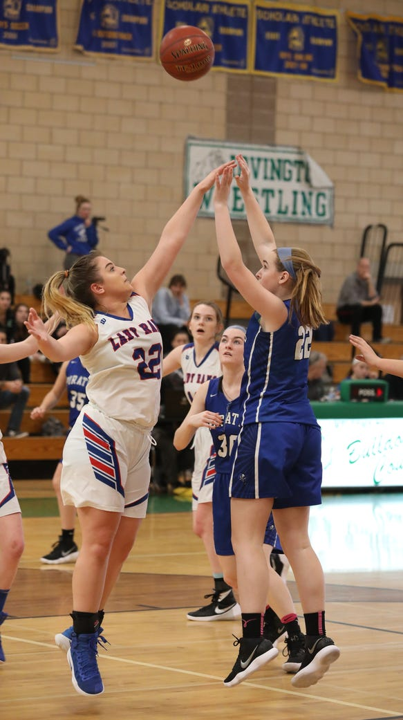 Pearl River's Kelly Buchan goes up for a shot over