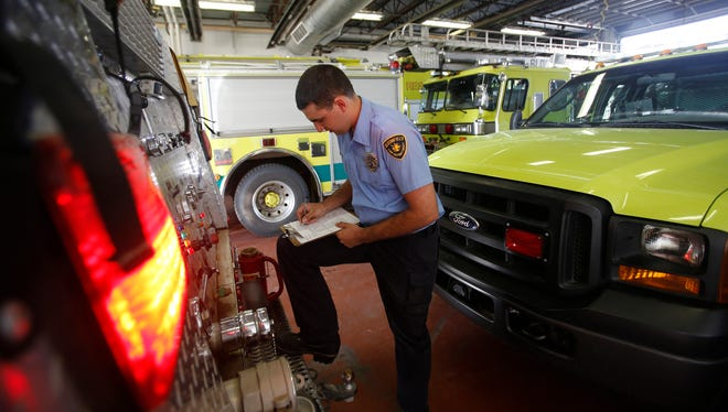 Bloomfield firefighter Tony Herrera checks on a fire engine March 4 at the Bloomfield Fire Department.