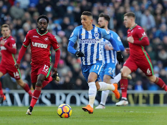 Brighton & Hove Albion's Anthony Knockaert runs with the ball, with Swansea City's Nathan Dyer, left, in action during their English Premier League soccer match at the AMEX Stadium in Brighton, England, Saturday Feb. 24, 2018. (Gareth Fuller/PA via AP)