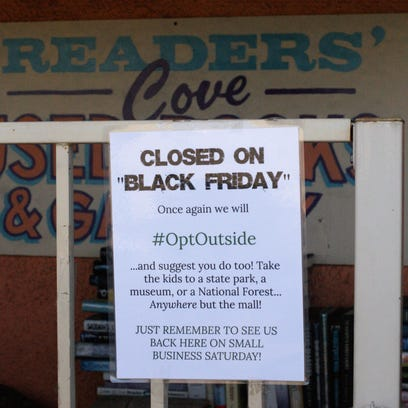 A sign on the gate of Reader's Cove Used Books and