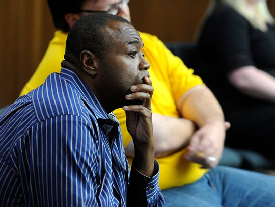 Abilene mayor-elect Anthony Williams listens in from