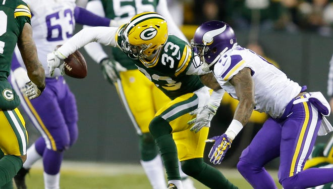 Packers strong safety Micah Hyde (33) makes a one handed interception in the third quarter against the  Vikings at Lambeau Field January 3, 2016.