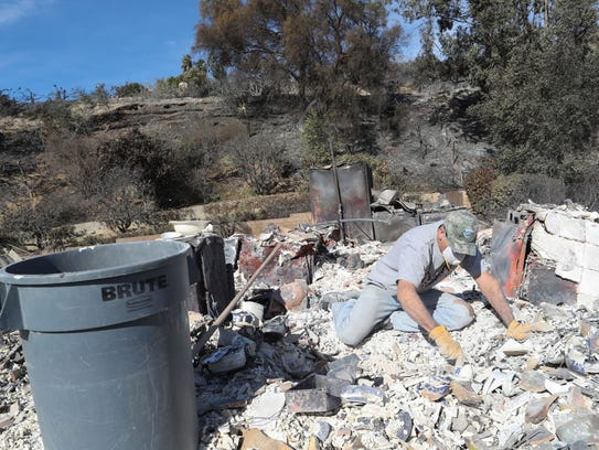David Karian sifts through the rubble of his parent's