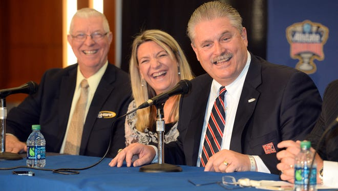 Eddie Bonnie smiles as he answers a question after being announced as the new executive director of the Louisiana High School Athletic Association in 2014. With Bonnie is his wife Christine and the LHSAA interim Executive Director Jimmy Anderson.