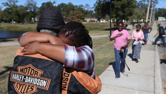 Beverly Freeney, 54, hadn't seen or heard from her father in more than 30 years until Saturday, Nov. 5, 2016 when they were reunited after the family's exhaustive search found Jimmy Smith on a registry for the old shelter in Tallahassee. Here the two meet at Carter-Howell-Strong Park where Jimmy had been strolling along the sidewalk.