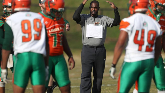 FAMU football coach Willie Simmons instructs his team during spring practice.