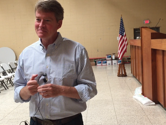 Chris Koster talks to reporters at Teamsters Local 245