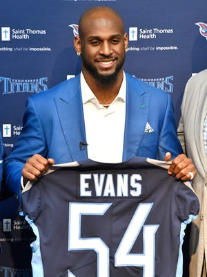 Titans first-round draft pick, Rashaan Evans holds up his new Titan's jersey at Saint Thomas Sports Park 