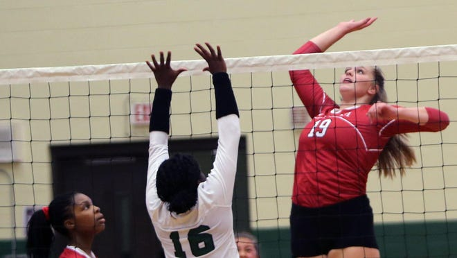 Hendersonville's Emily Beeker (19) gets ready to spike the ball as East Henderson's Sontee Moore (16) defends during last year's match at East.