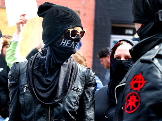 Members of Antifa wait to enter the White Lives Matter