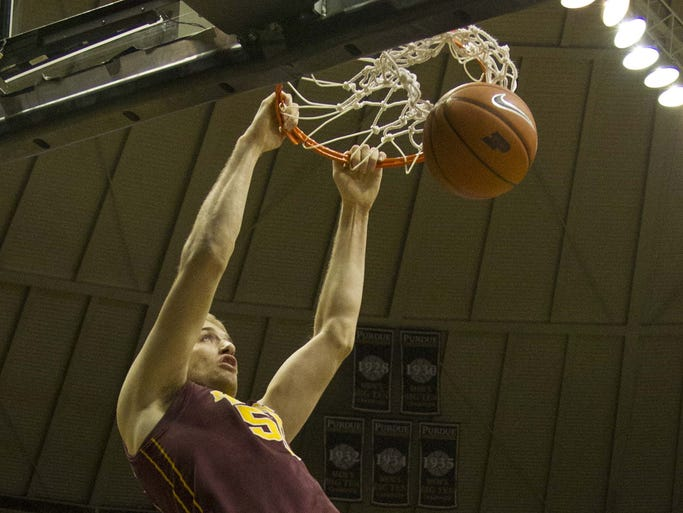 Feb 5, 2014; West Lafayette, IN, USA; Minnesota Golden Gophers center Elliott Eliason (55) slam dunks the basketball in the first half of the game against the Purdue Boilermakers at Mackey Arena. Mandatory Credit: Trevor Ruszkowski-USA TODAY Sports