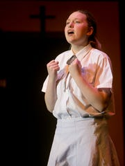 MacKenzie Frost performs as Sarah Brown during rehearsal
