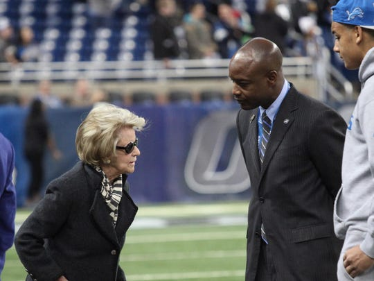 Lions owner Martha Ford chats Sunday with interim GM Sheldon White.