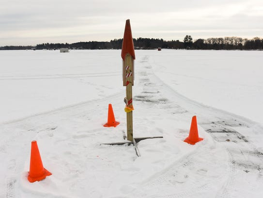 A post marks the center point of a planned 110-meter