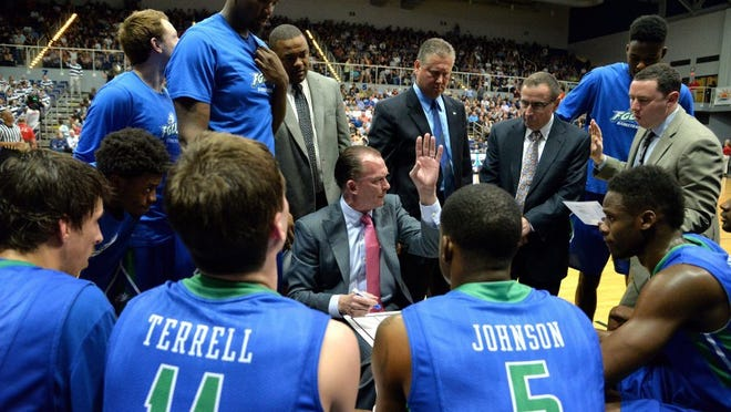 Bruce.Lipsky@jacksonville.com --03/03/16-- FGCU's Joe Dooley gathers his team as they start to pull away from UNF in the second half. The University of North Florida went cold as Florida Gulf Coast University won the Atlantic Sun Conference semi-final 89-56, in Jacksonville, Florida. (Florida Times-Union, Bruce Lipsky)