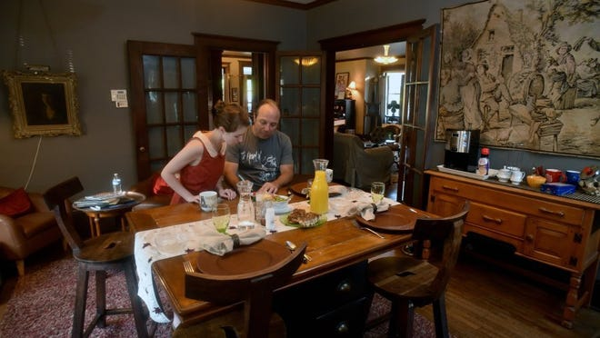 Laura Webb, left, and Michael Benton, from Paris, Ky., plan their day before breakfast at the bed-and-breakfast operated by Doug and Faith McDaniel in Knoxville. The city is looking at ordinances that would regulate airbnb rentals, which officials say would protect neighborhoods while still allowing operators to continue their business. It also would likely include requiring airbnb renters to pay hotel/motel tax. The McDaniels welcome clarification in the law.