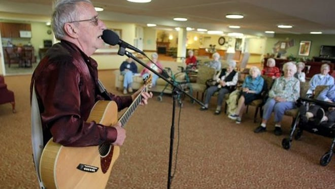 Patrick Haggerty performs in 2015 at a retirement facility, something he says he'll continue to do even though Lavender Country's popularity continues to ramp up.