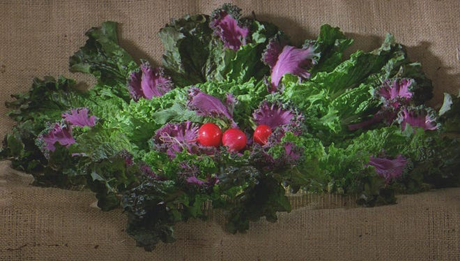 This salad includes red romaine, green leaf and kale with radishes.