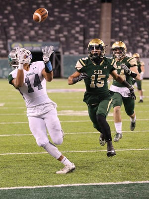 Ronnie Hickman of DePaul catches a second-half touchdown pass in front of defender Jim Ciarlo of St. Joseph.