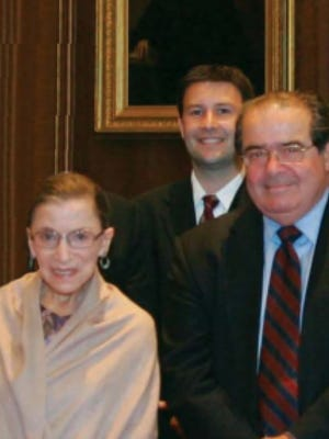 Leavenworth County Attorney Todd Thompson, center, meets U.S. Supreme Court Justices Ruth Bader Ginsburg and Antonin Scalia in 2010.
