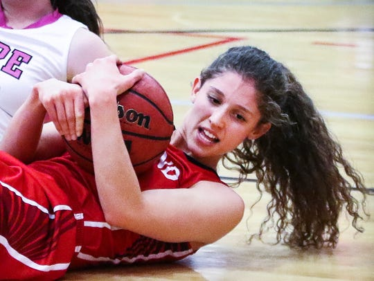 Oakland's Sloan Mann fights on the floor for possession