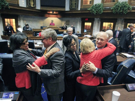 Indiana Senators share hugs after Sine Die in the Senate chamber, ending the 2014 General Assembly on Thursday, March 13, 2014. Shown left to right are Jean Breaux, D-Indianapolis; Ronnie Alting, R-Lafayette; Earline Rogers, D-Gary; Vaneta Becker, R-Evansville; and Luke Kenley, R-Noblesville.