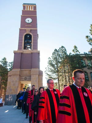 The SUU graduation processional passes through the bell tower on the way to the Centrum, Friday, April 28, 2017.