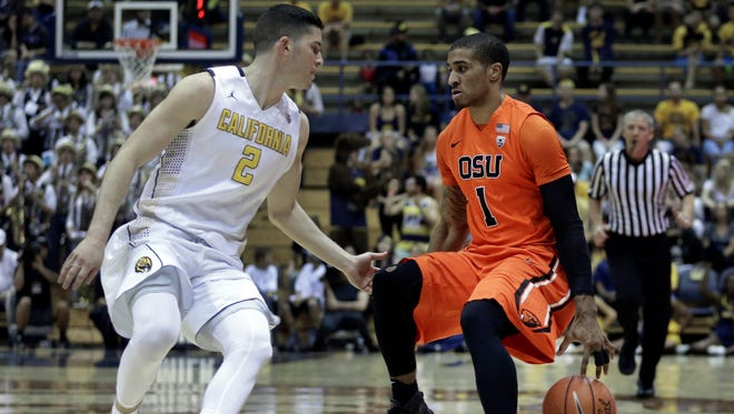 RETRANSMISSION TO CORRECT ID TO GARY PATTON II FROM MAURICE O'FIELD - Oregon State's Gary Payton II, right, drives the ball against California's Sam Singer (2) in the first half of an NCAA college basketball game Saturday, Feb. 13, 2016, in Berkeley, Calif. (AP Photo/Ben Margot)