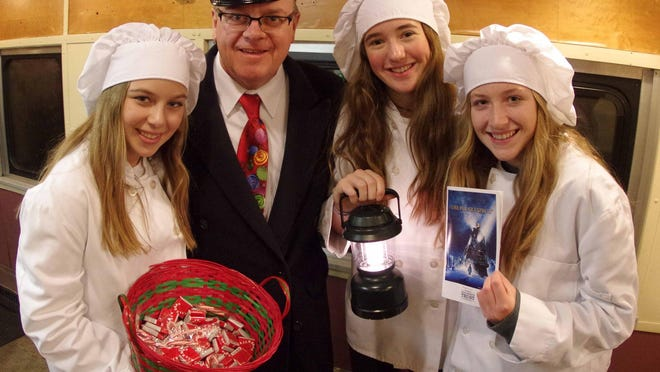 Conductor David Provost of Shelburne and his helper chefs on the Polar Express.