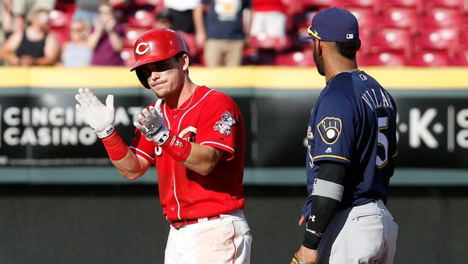 Since acquiring Scooter Gennett from the Brewers, the Reds have been happy with his production.