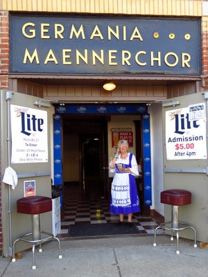 The Germania Maennerchor member Suzie Hass greets guests at the door of the 2015 Volksfest.