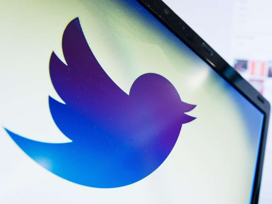 File photo dated September 11, 2013 shows the logo of the social networking website 'Twitter' displayed on a computer screen in London.