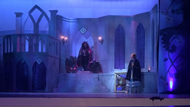 """Laura Fyre as Belle, meets the Beast, portrayed by Rocco Barbera in the OBSP production of """"Beauty and the Beast"""" at the Levoy Theatre in MIllville."""