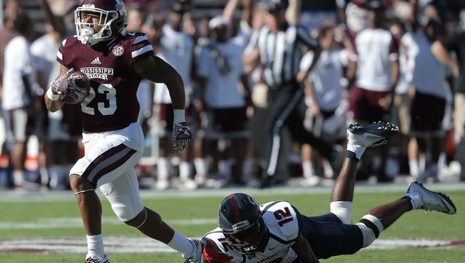 Mississippi State wide receiver Keith Mixon gets away from Samford's Omari Williams. Mixon had a touchdown called back because of a penalty.