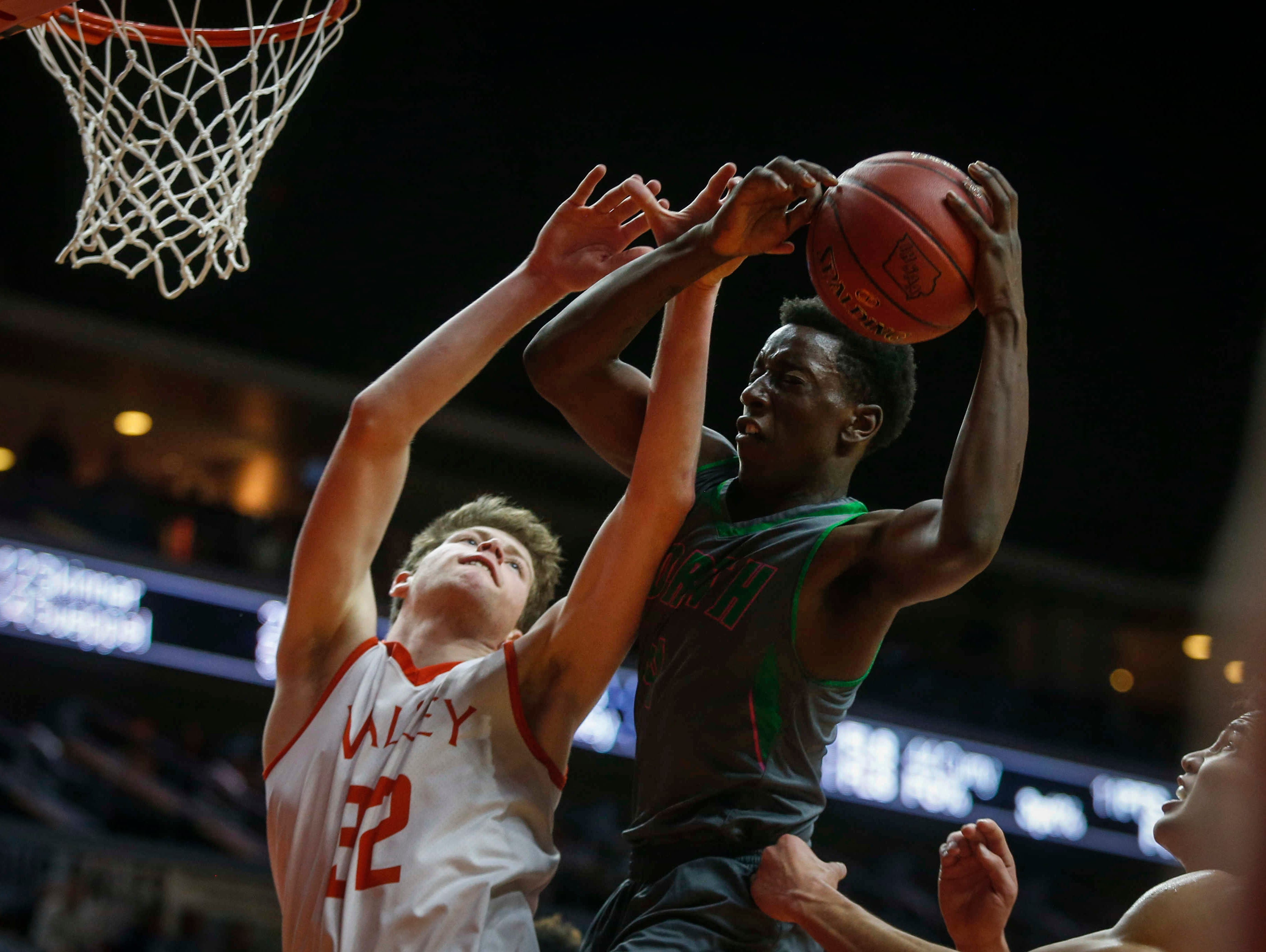 Des Moines north senior Dariq Myles pulls in a defensive rebound against Valley during the Iowa High School state basketball tournament at Wells Fargo Arena in Des Moines on Wednesday, March 8, 2017.