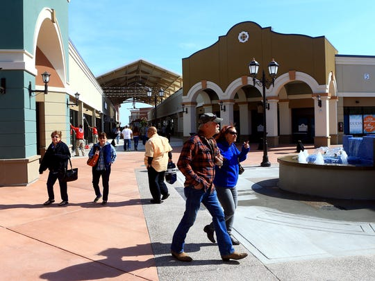 Shoppers walk around during the grand opening of the Outlets at Corpus Christi Bay on Thursday, March 2, 2017, in Robstown.